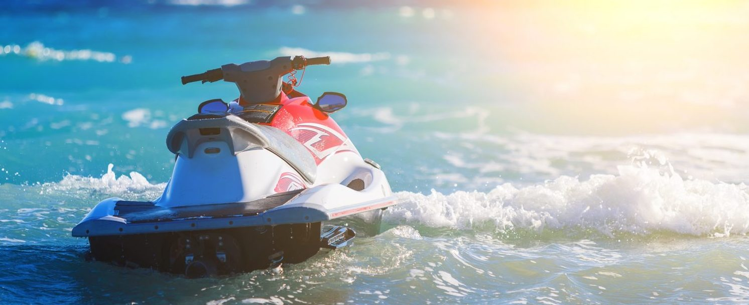 Jet Ski Moored inon on waves of sea - Santa rosa jet ski rentals