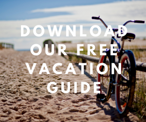 Bike on the sand with download our free vacation guide text