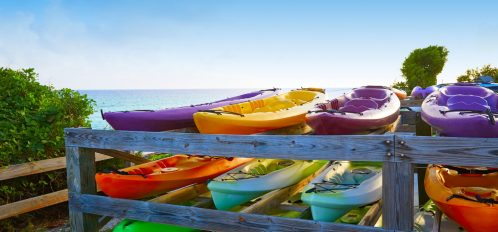 Santa Rosa Beach Kayak rentals stacked up overlooking the ocean and the beach
