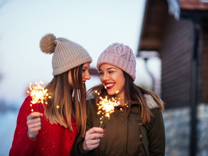 Photo of impatient young women waiting to have fun outside with sparklers at Sandestin New Year's Eve