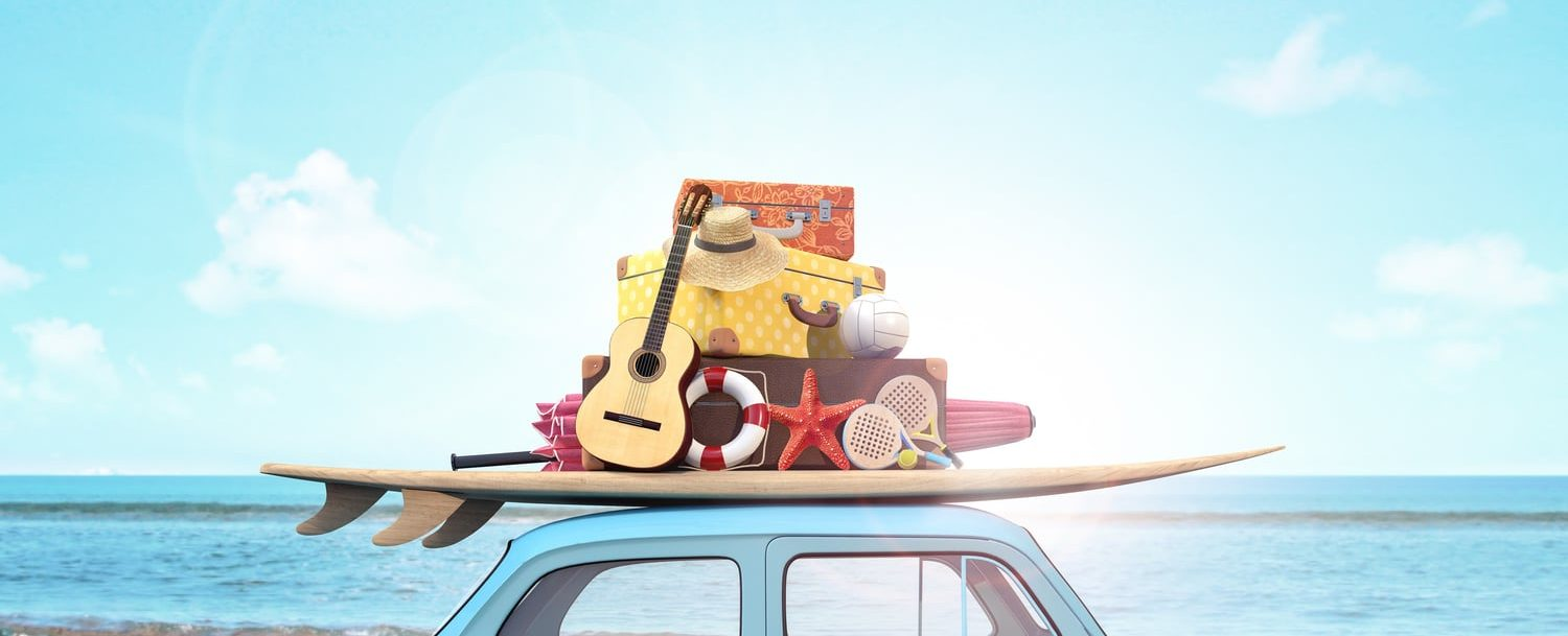 Car packed with vacation items like a hat, guitar and surf board for 30A Spring Break