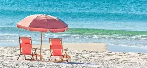 Beach chairs and umbrella by the water on a white sand beach   Blue Mountain Beach Weather