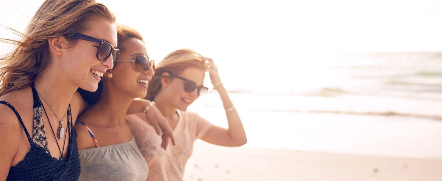 Girlfriends having fun on the beach at the village of Baytowne Wharf